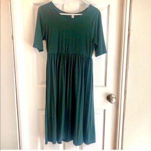 Calf length forest green dress.